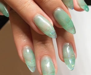 A very popular design and color of 2021, greens (specifically sage and jade tones), along with the mystical aura of crystal-like designs.