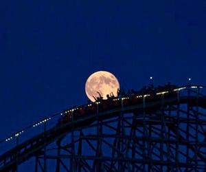 amusement park, blue, and blue sky image