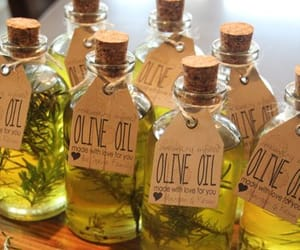 olive oil, rosemary infused, and olive oil - pepper image