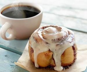 cinnamon roll and coffee image