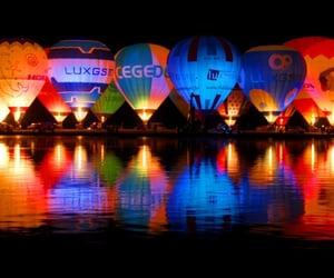 hot air balloons, night, and reflection image
