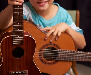 acoustic guitar lessons, ukulele lessons honolulu, and adult guitar lessons image