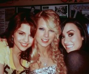 selena gomez, demi lovato, and Taylor Swift image