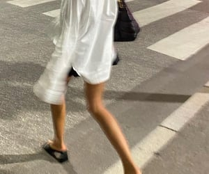 black heels, blurry, and button up shirt image