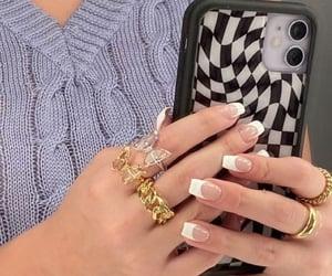 checkerboard, nails, and rings image