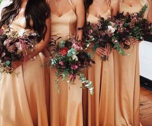 bride, friend, and bridesmaid image