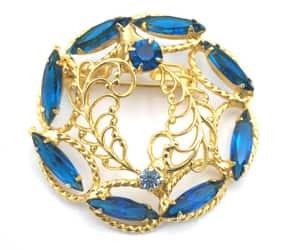 indigo blue, rhinestone brooch, and blue rhinestone image