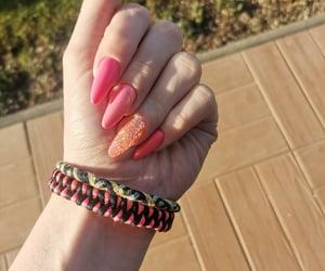 glitter, orange, and almond nails image
