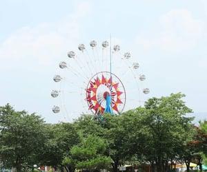 amusement park and ferris wheel image