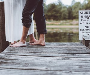 barefoot, couple, and sign image