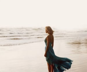 Taylor Swift, out of the woods, and beach image