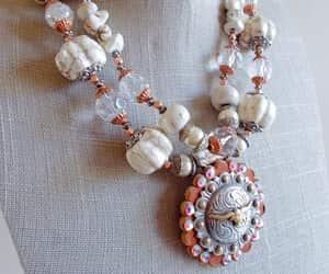 beaded necklace, ab rhinestones, and chunky statement image