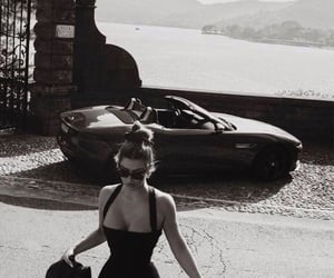 car, woman, and black and white image