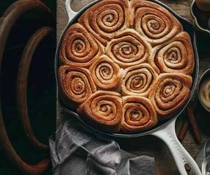 cake, cinnamon rolls, and coffee image