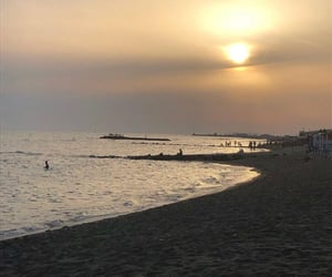 sea, sunset, and italy image