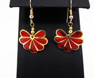 dangling, deep red, and gold tone image