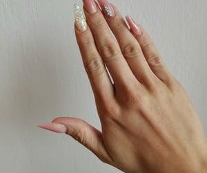 long, Swarovski, and nude nails image
