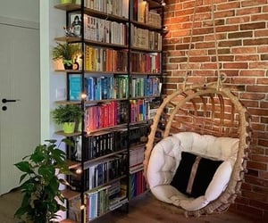 bamboo chair, books, and light image