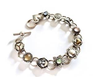 charm bracelet, casual bracelet, and costume jewelry image