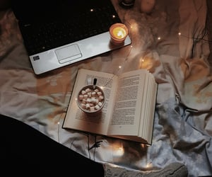 blankets, books, and candles image