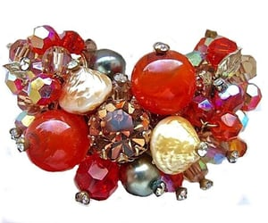 art glass, gold tone, and red rhinestones image