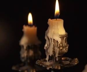 candles, dark, and flames image