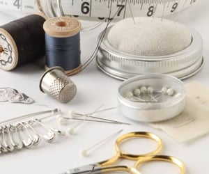 measuring tape, sewing, and needles image