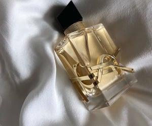 perfume, YSL, and luxury image