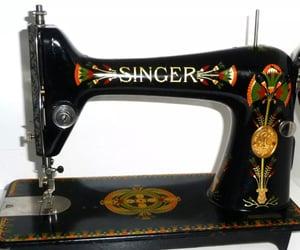 singer, singer sewing machine, and egyptian lotus image