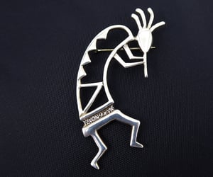 american indian, sterling silver, and flute player image