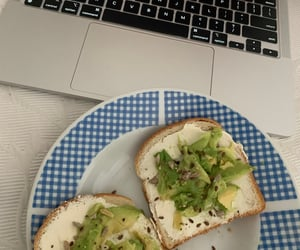 bed, macbook, and avocado toast image