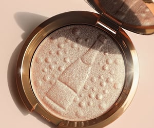 highlighter, pressed powder, and makeup image