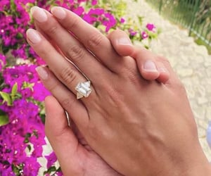 diamonds, emerald, and engagement ring image