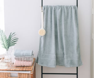 bathroom, beach towel, and bath towel image