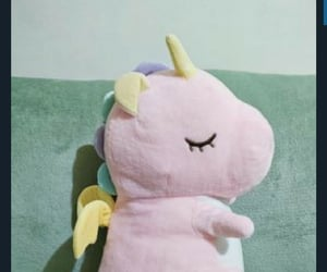 dino, unicorn, and stuffed toy image