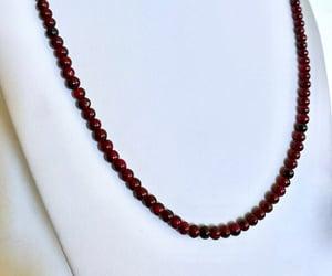 handcrafted, sparkling gemstones, and red plum garnets image