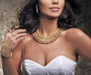 gold necklace, wedding rings, and gold bangles image