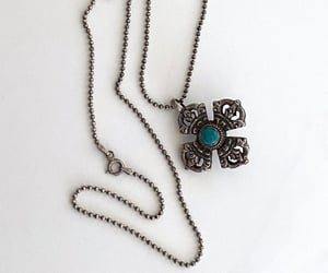 coral, turquoise, and maltese cross image