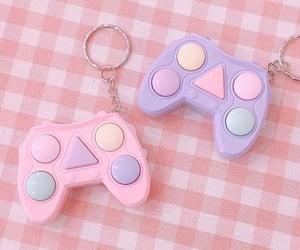 joystick, keychain, and pastel image