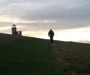lighthouse, sunset, and i walk alone image