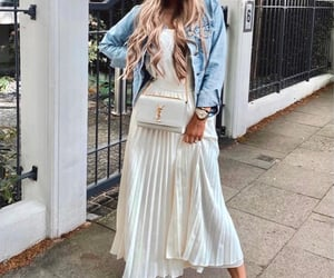 tee and pleated skirt image