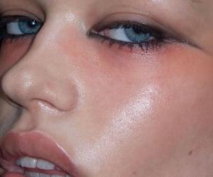 Black Eyeliner, blush, and makeup image