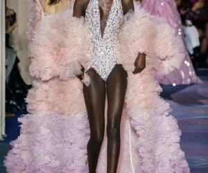 Couture, high heels, and runway image