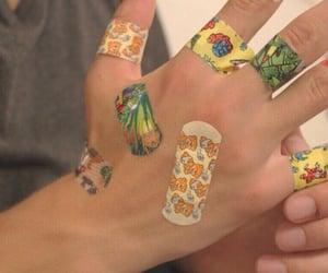 bandaid, hands, and bandaids image
