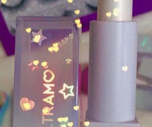 gloss, lip balm, and lipstick image