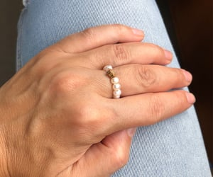 clover, pearls, and hand image