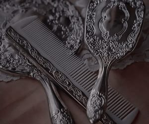 hairbrush, Queen, and mirror image
