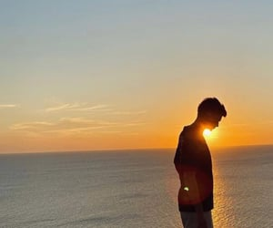 boy, sea, and shadow image