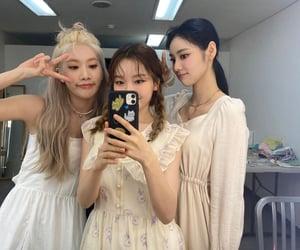 jinsoul, gowon, and kim lip image