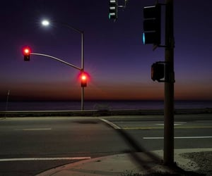 intersection, night, and traffic lights image